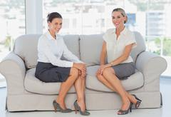 Stock Photo of Business women sitting on the couch