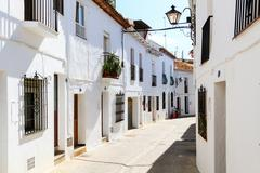 beautiful street with flowers in the mijas town, spain - stock photo