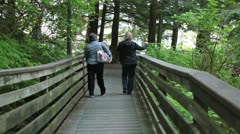 Two women on boardwalk having fun Ketchikan Alaska HD 7545 Stock Footage
