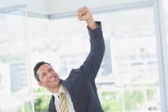 Businessman raising up his hand Stock Photos