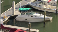 FX7 Boat In Marina Zoom Out Stock Footage