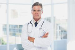 Grey haired doctor - stock photo