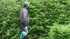 Landscape worker with an electric bush cutter episode 1 Stock Footage