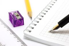 Notepad with stationary objects Stock Photos