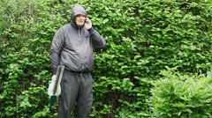 Landscape worker with an electric bush cutter episode 2 Stock Footage