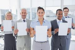 Stock Photo of Business team showing blank pages