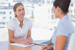 Woman having a job interview with a businesswoman - stock photo