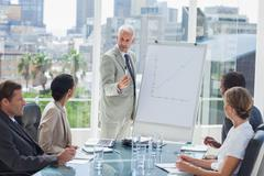 Serious businessman giving a presentation - stock photo