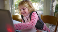 Stock Video Footage of young girl using a computer