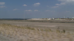 vehicle shot - reclaimed land with construction works for Maasvlakte 2 - stock footage