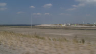 Stock Video Footage of vehicle shot - reclaimed land with construction works for Maasvlakte 2