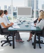 Stock Photo of Business people gathered for a video conference
