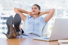 Attractive businesswoman having a nap Stock Photos