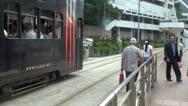 Fast motion of tram traffic, station, Hong Kong, China Stock Footage
