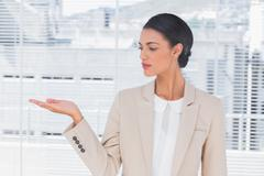 Stock Photo of Attractive businesswoman opening her hand