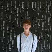 Thinking business man with chalk exclamation marks Stock Photos