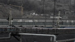 Two cranes loading coal Stock Footage