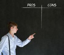 Stock Photo of businessman, student or teacher pros and cons decision list