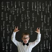 Knowledge rocks boy business man with chalk exclamation marks Stock Photos