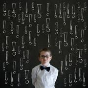 Thinking boy business man with chalk exclamation marks Stock Photos