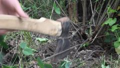 Branches are cut down with an ax 7 Stock Footage