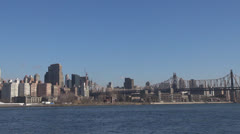 View to Queensboro  Bridge and Downtown Manhattan by day, New York City, USA Stock Footage