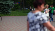 People crowd in the city park alley Stock Footage