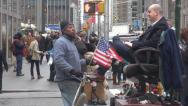 Stock Video Footage of Shoeshiner man busy sidewalk pedestrians businessman day Manhattan New York USA
