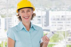 Stock Photo of Smiling architect looking at camera