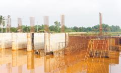 Dam construction site after rainstorm. Stock Photos