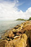 stone wave barrier near seashore. - stock photo