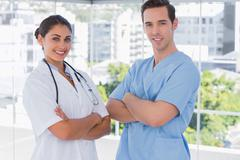 Medical staff standing together with arms folded - stock photo
