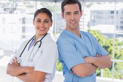 Medical staff standing with arms crossed - stock photo