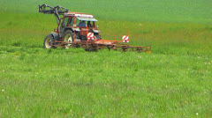 Hay harvesting Tractor trimming cutting collecting Hay grasses Stock Footage