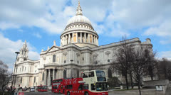 St Paul´s Cathedral with some people, cars and red bus passing by 4 Stock Footage