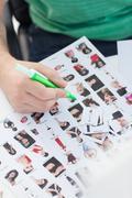 Photo editor marking photographs of contact Stock Photos