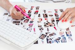 Stock Photo of Female photo editor working on a contact sheet