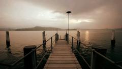Pier bridge lake view sunset carefree Stock Footage