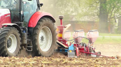Tractor sowing seeding corn seeds in Spring field Stock Footage