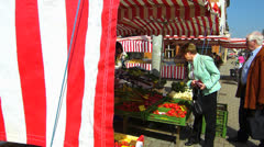Erlangen open main market grocery vegetable flower vendor stall Stock Footage