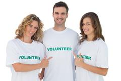 Group of volunteers pointing their tshirt Stock Photos