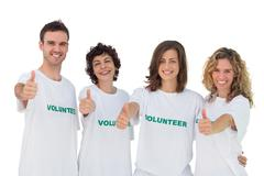Cheerful group of volunteers giving thums up - stock photo