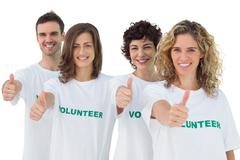 Group of volunteers giving thumbs up - stock photo