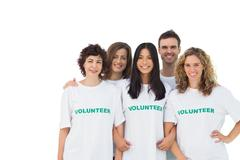 Smiling group of volunteers standing - stock photo