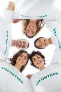 Low angle view of a smiling group of volunteers - stock photo