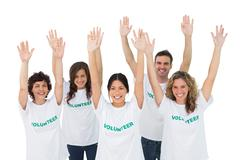 Stock Photo of Group of volunteers raising arms