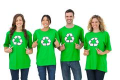 Group of environmental activists pointing their tshirt Stock Photos