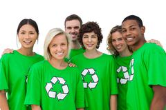 Group of smiling activists wearing green shirt with recycling symbol on it Stock Photos