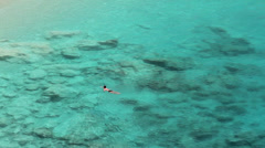 Lonely swimmer in turquoise waters Stock Footage