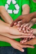 Activists piling up their hands together Stock Photos
